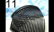 11 Black plastics comb (around 8.5cm x 5cm)